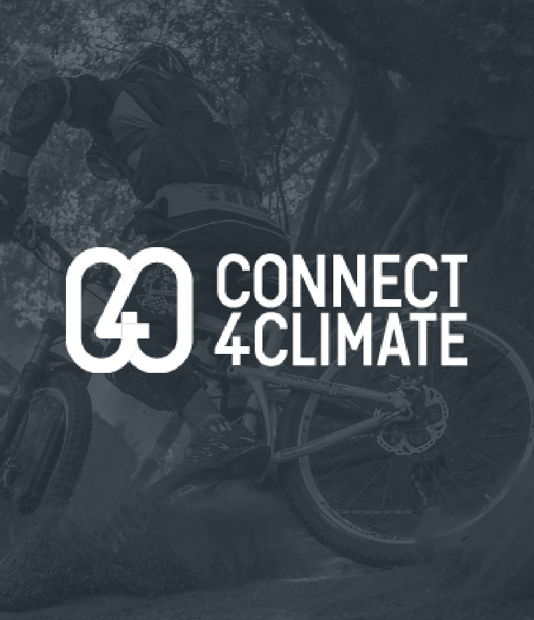 Image of man in bicycle. This is for Connect 4 Climate.